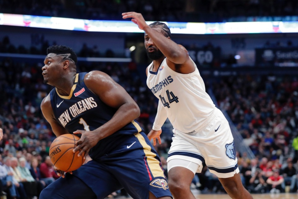 <strong>New Orleans Pelicans forward Zion Williamson (1) make a move to the basket next to Memphis Grizzlies forward Solomon Hill (44) in New Orleans, Friday, Jan. 31, 2020.</strong> (Gerald Herbert/AP)