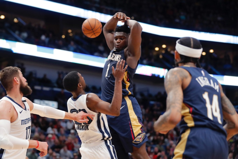 <strong>New Orleans Pelicans forward Zion Williamson (1) is fouled by Memphis Grizzlies guard Josh Jackson in New Orleans, Friday, Jan. 31, 2020.</strong> (Gerald Herbert/AP)