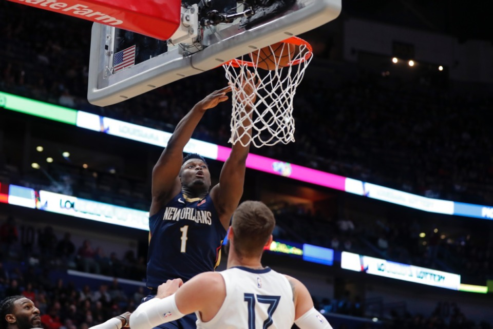 <strong>New Orleans Pelicans forward Zion Williamson (1) scores over Memphis Grizzlies center Jonas Valanciunas (17) in New Orleans, Friday, Jan. 31, 2020.</strong> (Gerald Herbert/AP)