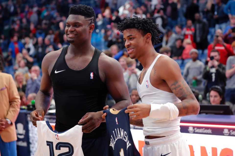 <strong>New Orleans Pelicans forward Zion Williamson, left, and Memphis Grizzlies guard Ja Morant exchange jerseys after the game in New Orleans, Friday, Jan. 31, 2020. The Pelicans won 139-111.</strong> (AP Photo/Gerald Herbert)