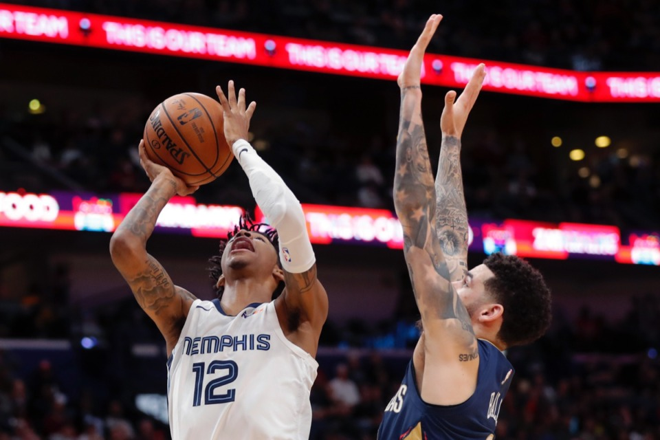 <strong>Memphis Grizzlies guard Ja Morant (12) goes to the basket against New Orleans Pelicans guard Lonzo Ball in New Orleans, Friday, Jan. 31, 2020. The Pelicans won 139-111.</strong> (AP Photo/Gerald Herbert)
