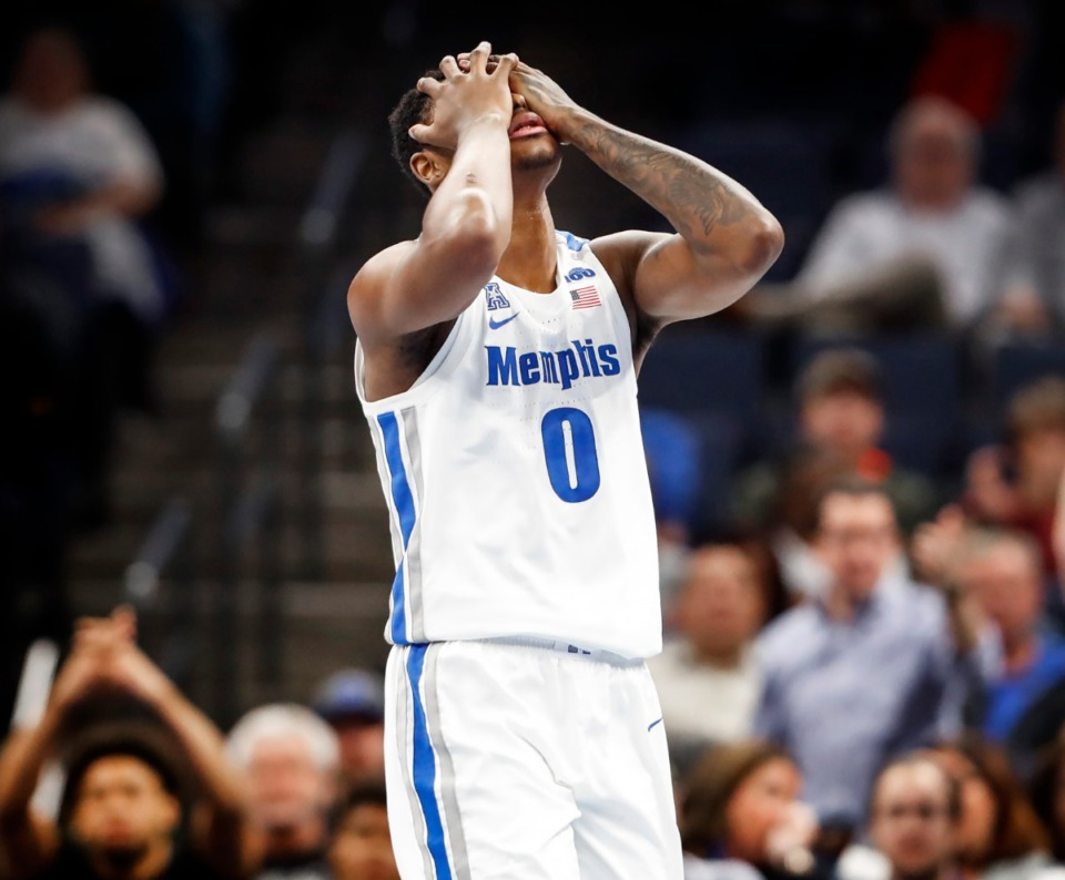 <strong>Memphis forward D.J. Jeffries covers his face after fouling out during action against Little Rock on Nov. 20, 2019, at FedExForum. Jeffries has suffered a partially torn posterior cruciate ligament and is expected to be out four to six weeks.</strong> (Mark Weber/Daily Memphian)