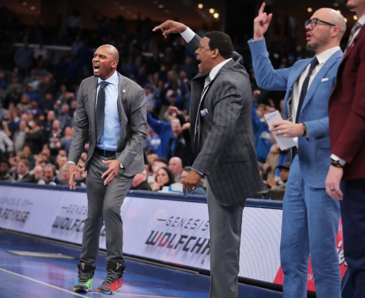 <strong>University of Memphis coaches Penny Hardaway (left), Tony Madlock and Cody Toppert react to a referee's call on the court during the Tigers' game on Feb. 1, 2020, against Connecticut at FedExForum in Memphis.</strong> (Jim Weber/Daily Memphian)