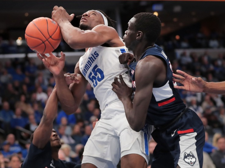 <strong>University of Memphis forward Precious Achiuwa (55) shoots under pressure by the Huskies' Akok Akok (right) and Alterique Gilbert (left) during the Tigers' game on Feb. 1, 2020, against Connecticut at FedExForum in Memphis.</strong> (Jim Weber/Daily Memphian)