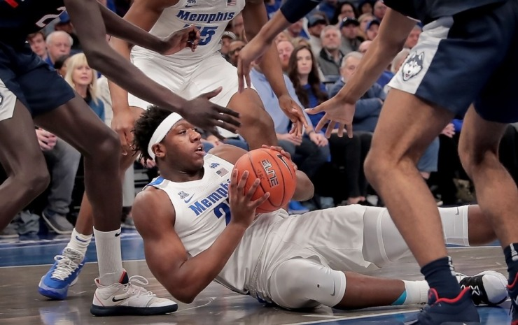 <strong>University of Memphis forward Malcolm Dandridge (center) looks for an open man after picking up a loose ball during the Tigers' game on Feb. 1, 2020, against Connecticut at FedExForum in Memphis.</strong> (Jim Weber/Daily Memphian)