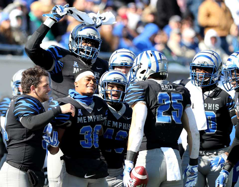 <strong>The Memphis Tigers bench celebrates with the Tigers' outside linebacker Austin Hall (25) after he recovered a fumble in a game against Tulsa on Saturday, Nov. 10, 2018.</strong>&nbsp; (Houston Cofield/Daily Memphian)