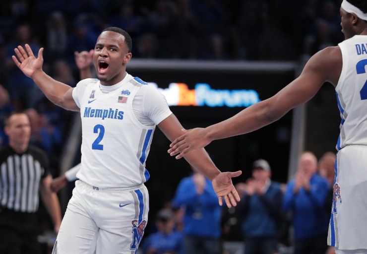 <strong>University of Memphis guard Alex Lomax (2) celebrates with Malcolm Dandridge (right) after a scoring drive during the Tigers' game on Feb. 1, 2020, against Connecticut at FedExForum in Memphis.</strong> (Jim Weber/Daily Memphian)