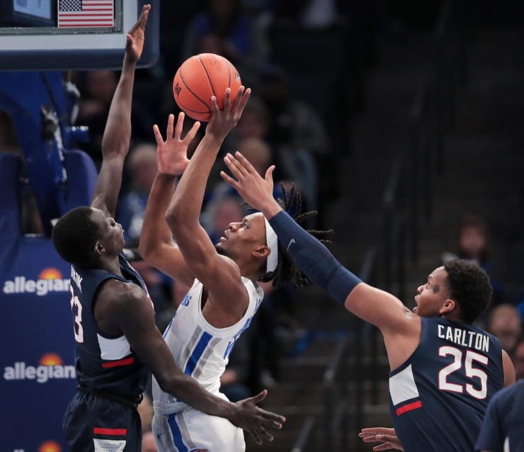 <strong>University of Memphis forward Precious Achiuwa (55) shoots under pressure by the Huskies Akok Akok (left) and Josh Carlton (25) during the Tigers' game on Feb. 1, 2020, against Connecticut at FedExForum in Memphis.</strong> (Jim Weber/Daily Memphian)