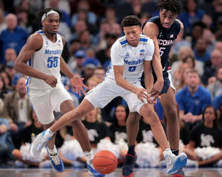 <strong>University of Memphis guard Boogie Ellis (5) and Precious Achiuwa (55) lose control of the ball under pressure by the Huskies' Isaiah Whaley (right) during the Tigers' game on Feb. 1, 2020, against Connecticut at FedExForum in Memphis.</strong> (Jim Weber/Daily Memphian)