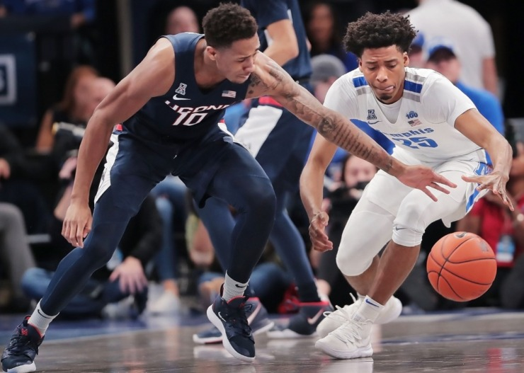 <strong>University of Memphis guard Jayden Hardaway (25) scrambles for a loose ball under pressure by the Huskies' Brendan Adams (10) during the Tigers' game on Feb. 1, 2020, against Connecticut at FedExForum in Memphis.</strong> (Jim Weber/Daily Memphian)