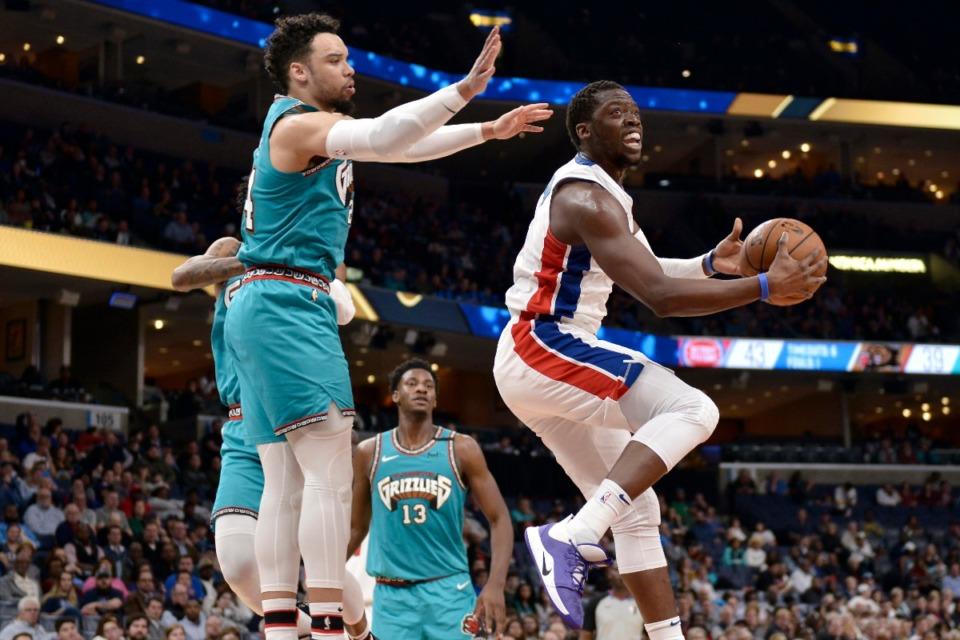 <strong>Memphis Grizzlies guard Dillon Brooks defends against Detroit Pistons guard Reggie Jackson, right, Feb. 3, 2020, at FedExForum.</strong> (Brandon Dill/AP)