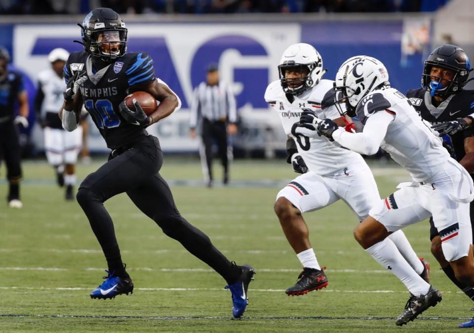 <strong>Memphis receiver Damonte Coxie (left) outruns the Cincinnati defense Nov. 29, 2019, at the Liberty Bowl.</strong> (Mark Weber/Daily Memphian)