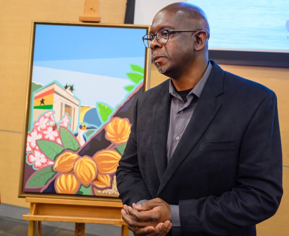<strong>Carl Moore, this year's artist for the Memphis in May poster honoring the Republic of Ghana, stands by his painting after the unveiling ceremony at the National Civil Rights Museum on Feb. 4, 2020.</strong> (Greg Campbell/Special to The Daily Memphian)