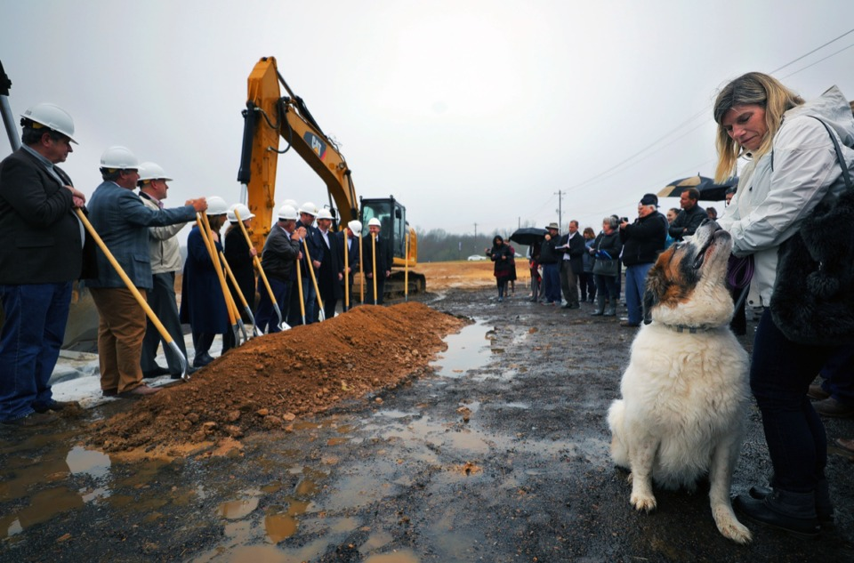 <strong>Gus the dog does his best to get the attention of Jean McGhee during the Lake District&rsquo;s groundbreaking Feb. 5, 2020. Groundbreaking signals the start of vertical construction for the $400 million mixed-use development in Lakeland.</strong> (Patrick Lantrip/Daily Memphian)