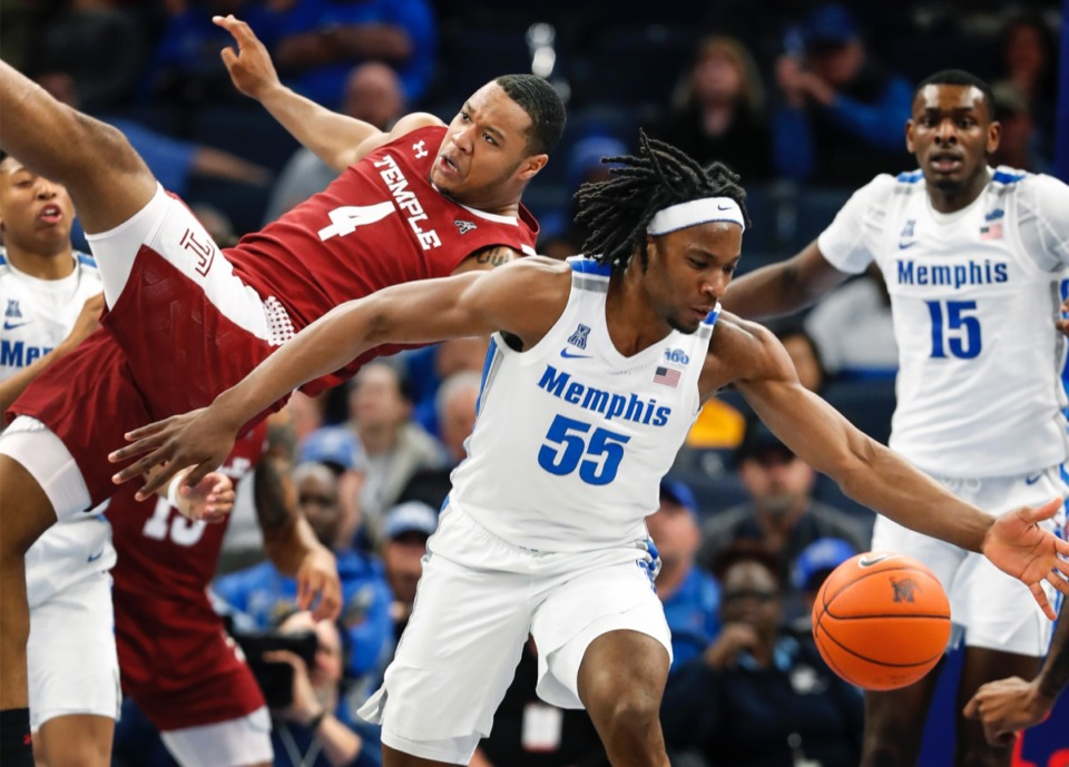 <strong>It's a battle for a rebound between Memphis forward Precious Achiuwa (right) and Temple's J.P. Moorman II (left) Feb. 5, 2020, at FedExForum.</strong> (Mark Weber/Daily Memphian)