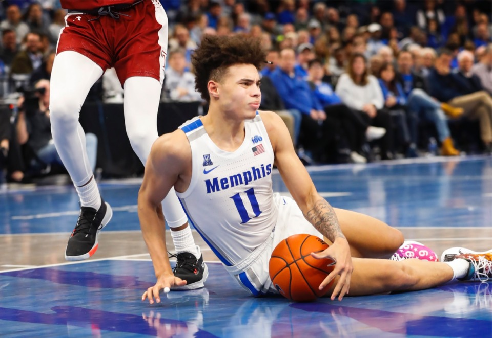 <strong>Lester Quinones hits the ground after being fouled in the game against Temple Feb. 5, 2020, at FedExForum.</strong> (Mark Weber/Daily Memphian)
