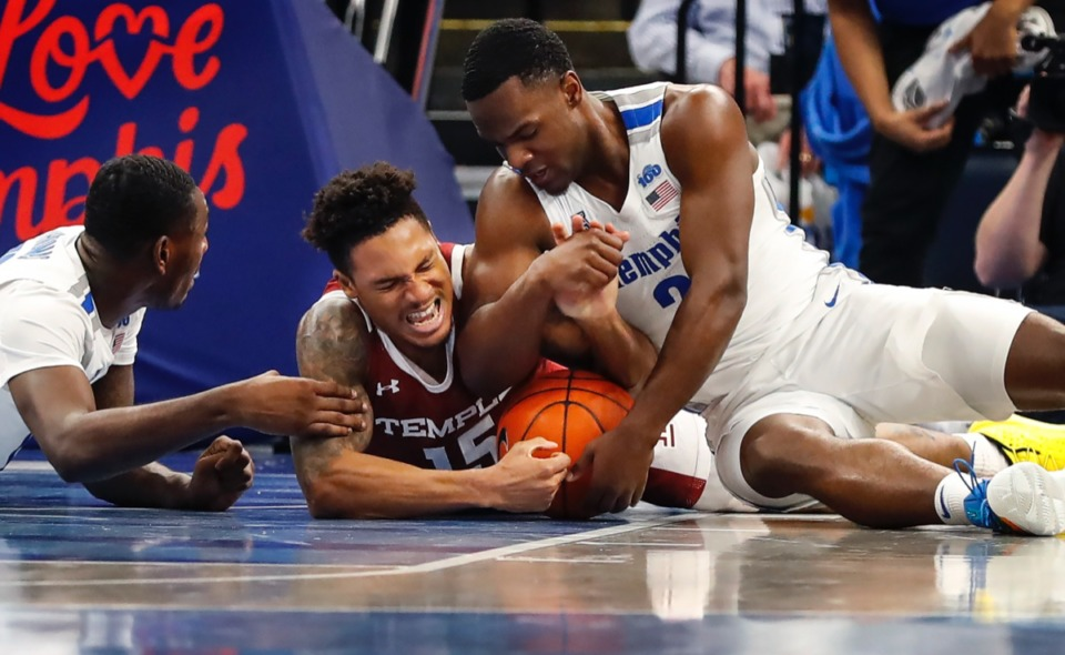 <strong>Memphis defenders Lance Thomas (left) and Alex Lomax (right) battle Temple guard Nate Pierre-Louis for a loose ball Feb. 5, 2020, at FedExForum.</strong> (Mark Weber/Daily Memphian)