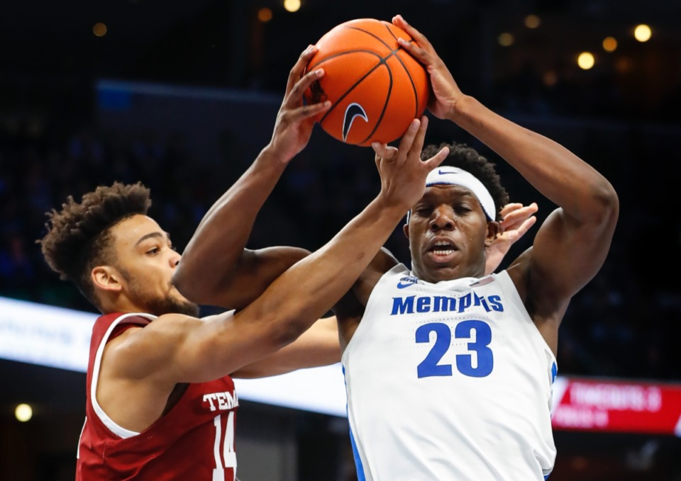 <strong>Memphis forward Malcolm Dandridge (right) grabs a rebound away from Temple's Arashma Parks (left) Feb. 5, 2020, at FedExForum.</strong> (Mark Weber/Daily Memphian)