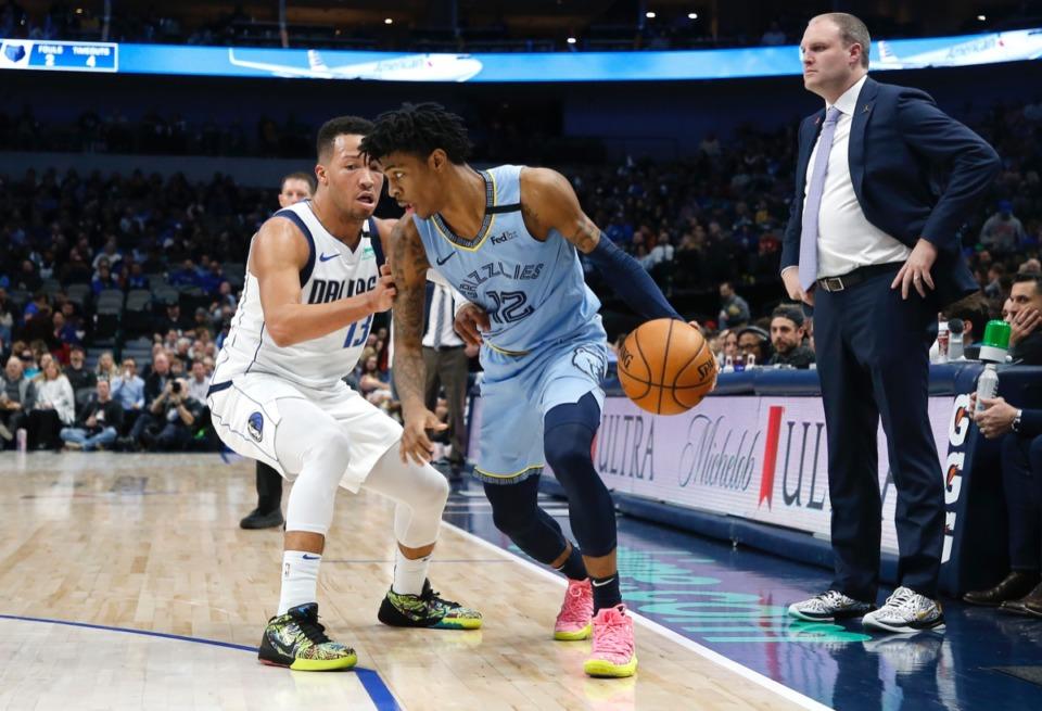 <strong>Memphis Grizzlies guard Ja Morant (12, with ball) works against Dallas Mavericks guard Jalen Brunson (13), while Grizzlies coach Taylor Jenkins supervises Feb. 5, 2020, in Dallas.</strong> <strong>The Grizzlies won 121-107.</strong> (Ron Jenkins/AP)