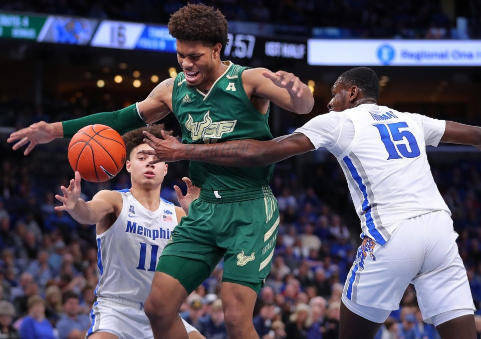"""<strong>University of Memphis forward Lance Thomas (15) steals the ball from the Bulls' David Collins (center) during the Tigers' game on Feb. 8, 2020,&nbsp;</strong><span class=""""s1""""><strong>against the University of South Florida at FedExForum in Memphis.</strong> (Jim Weber/Daily Memphian)</span>"""