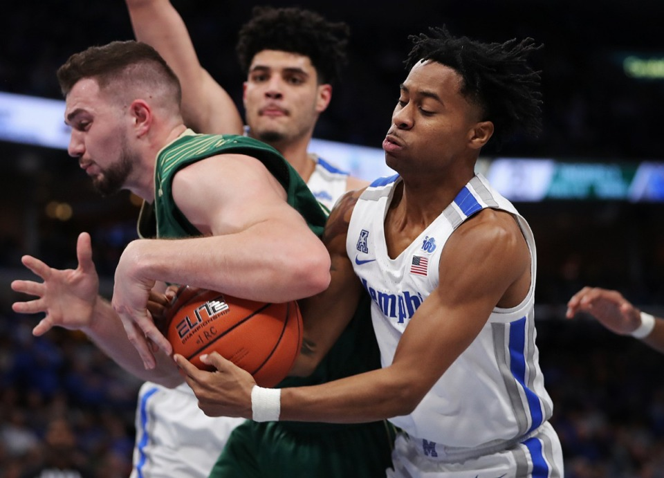 <strong>University of Memphis guard Tyler Harris steals the ball from under the arm of the Bulls' Antun Maricevic (left) during the Tigers' game on Feb. 8, 2020, against the University of South Florida at FedExForum in Memphis.</strong> (Jim Weber/Daily Memphian)