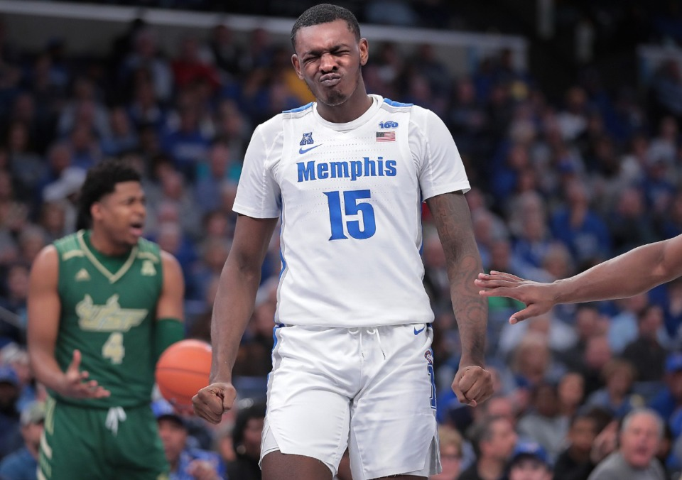 """<strong>University of Memphis forward Lance Thomas (15) reacts after getting poked in the face by the Bulls' Michael Durr (4) during the Tigers' game on Feb. 8, 2020,&nbsp;</strong><span class=""""s1""""><strong>against the University of South Florida at FedExForum in Memphis. </strong>(Jim Weber/Daily Memphian)</span>"""