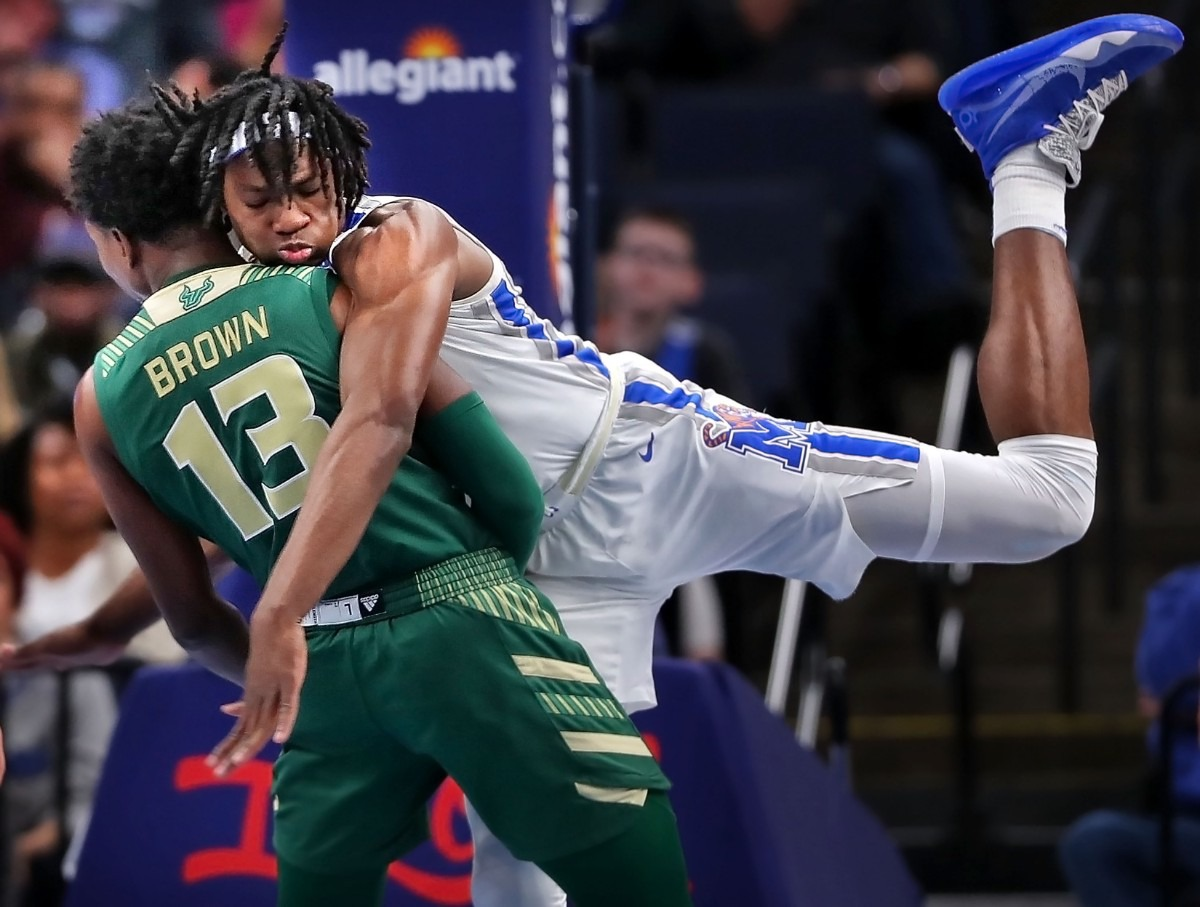 <strong>University of Memphis forward Precious Achiuwa (right) collides with the Bulls' Justin Brown during the Tigers' game on Feb. 8, 2020, against USF at FedExForum in Memphis.</strong> (Jim Weber/Daily Memphian)