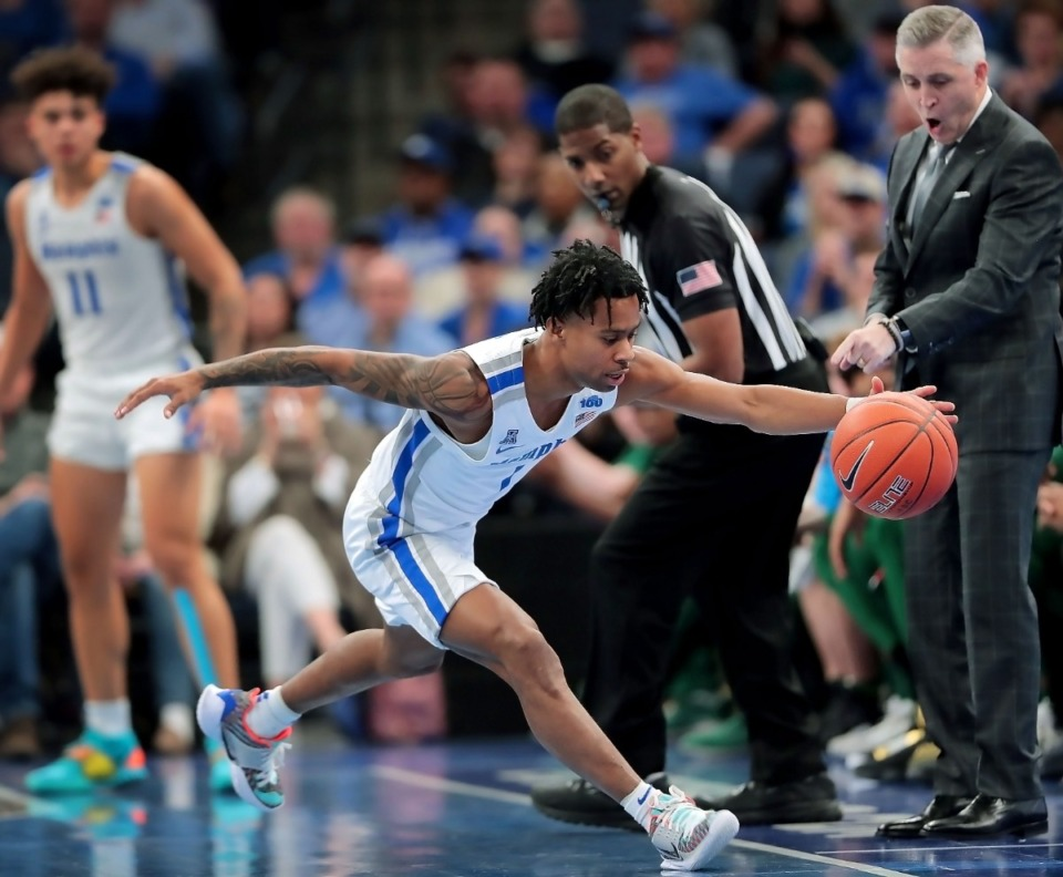 <strong>University of Memphis guard Tyler Harris stretches to pull a loose ball inbound during the Tigers' game on Feb. 8, 2020, against USF at FedExForum in Memphis.</strong> (Jim Weber/Daily Memphian)