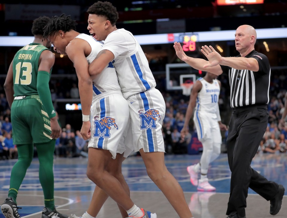 <strong>University of Memphis guards Tyler Harris (left) and Boogie Ellis react to a foul call during the Tigers' game on Feb. 8, 2020, against USF at FedExForum in Memphis.</strong> (Jim Weber/Daily Memphian)