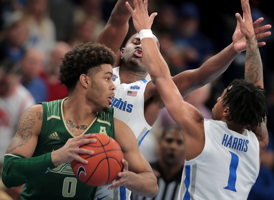 <strong>University of Memphis guards Alex Lomax and Tyler Harris (1) put pressure on the Bulls' David Collins (0) during the Tigers' game on Feb. 8, 2020, against USF at FedExForum in Memphis.</strong> (Jim Weber/Daily Memphian)