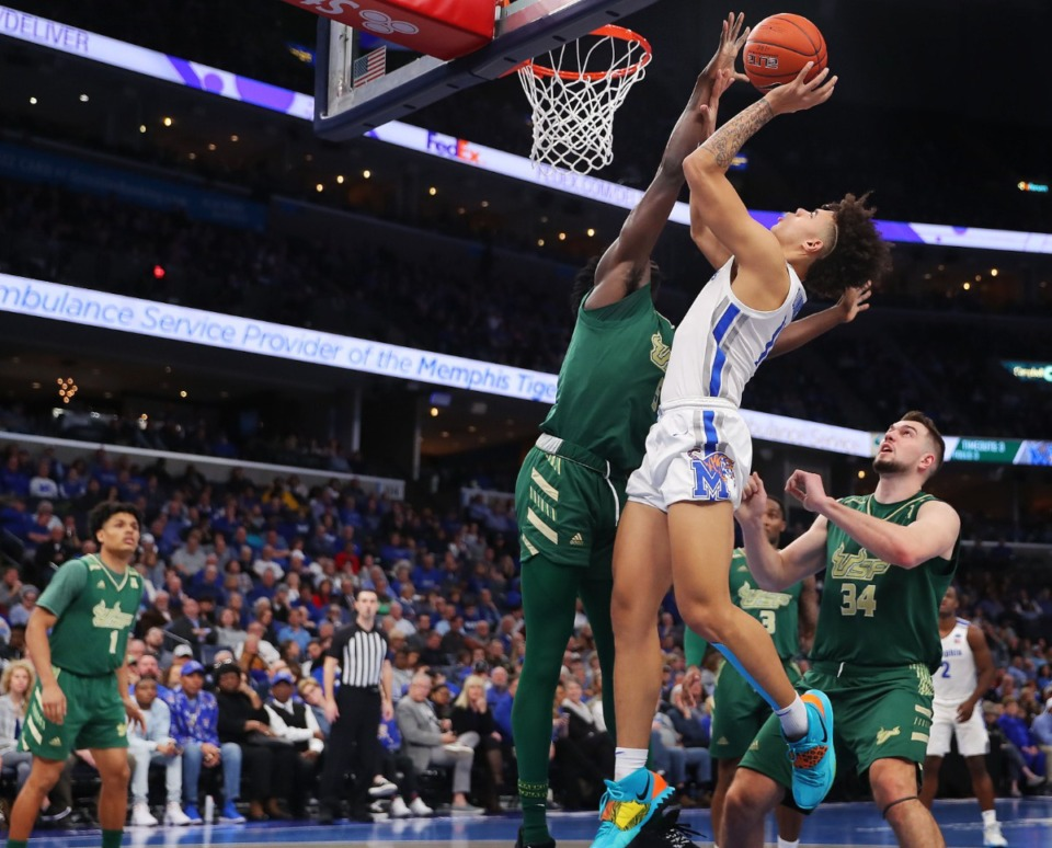 <strong>University of Memphis guard Lester Quinones shoots under pressure by the Bulls' Rashun Williams during the Tigers' game on Feb. 8, 2020, against USF at FedExForum in Memphis.</strong> (Jim Weber/Daily Memphian)