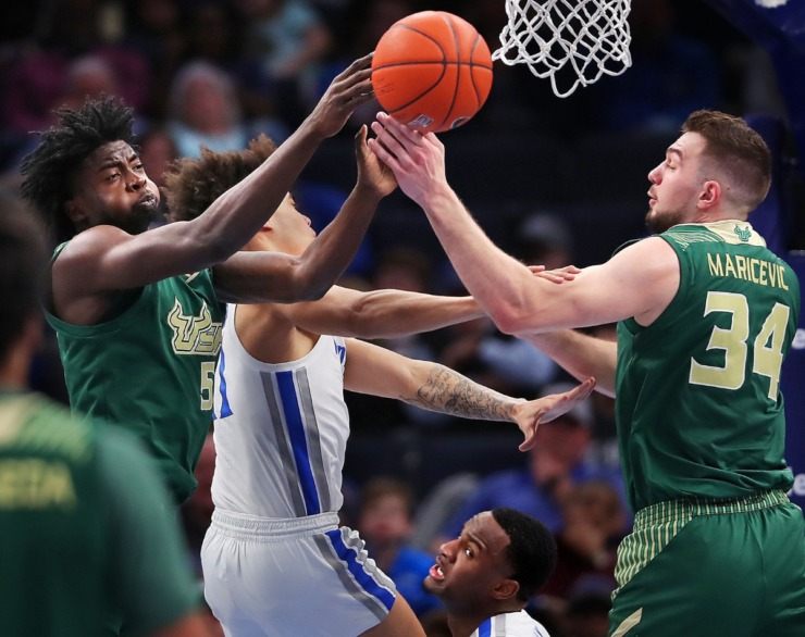 <strong>Bulls guard Rashun Williams (5) and forward Antun Maricevic pull down a rebound under pressure by University of Memphis guard Lester Quinones during the Tigers' game on Feb. 8, 2020, against USF at FedExForum in Memphis.</strong> (Jim Weber/Daily Memphian)