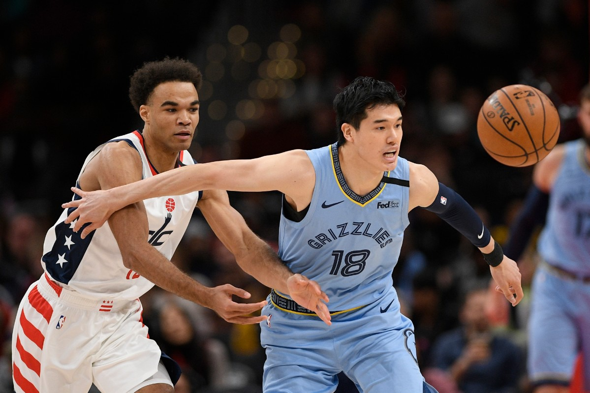<strong>Memphis Grizzlies guard Yuta Watanabe (18) and Washington Wizards guard Jerome Robinson (left) battle for the ball during the first half of an NBA game on Feb. 9, 2020, in Washington.</strong> (AP Photo/Nick Wass)