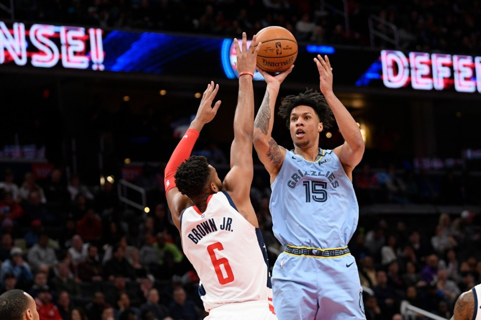 <strong>Memphis Grizzlies forward Brandon Clarke (15) shoots against Washington Wizards forward Troy Brown Jr. (6) during the first half of an NBA game on Feb. 9, 2020, in Washington.</strong> (AP Photo/Nick Wass)