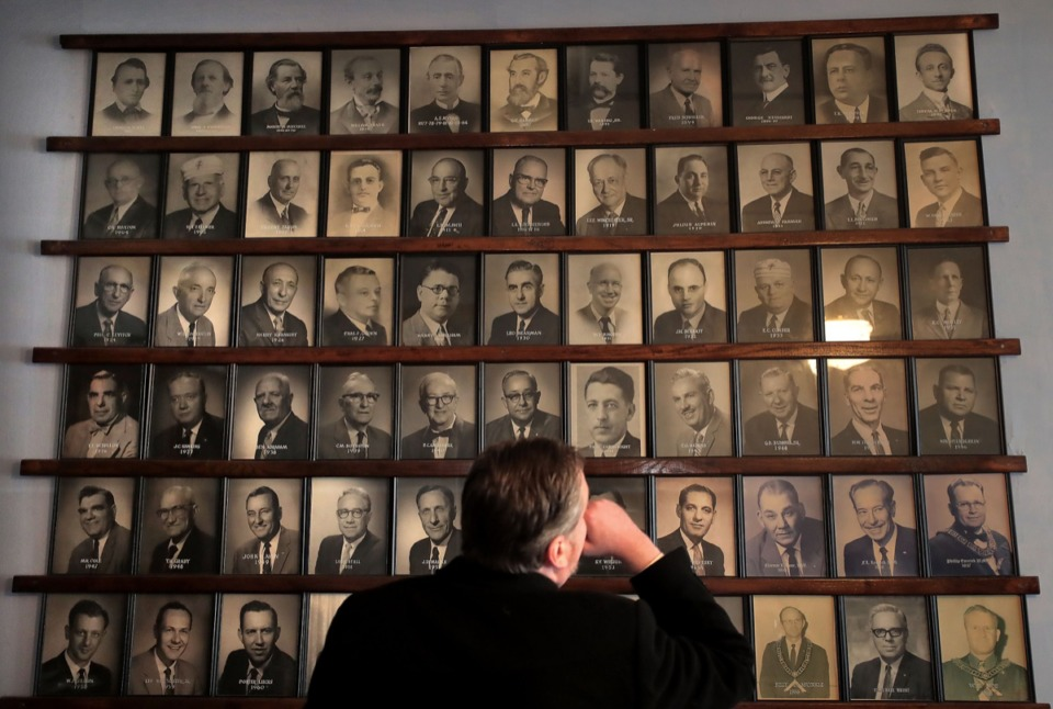 <strong>Past master Mason and broker James McCraw with Avison Young looks over a wall of former Worshipful Masters during a tour on Feb. 8, 2020, of the Masonic Lodge at 272 Court Avenue.</strong> (Jim Weber/Daily Memphian)