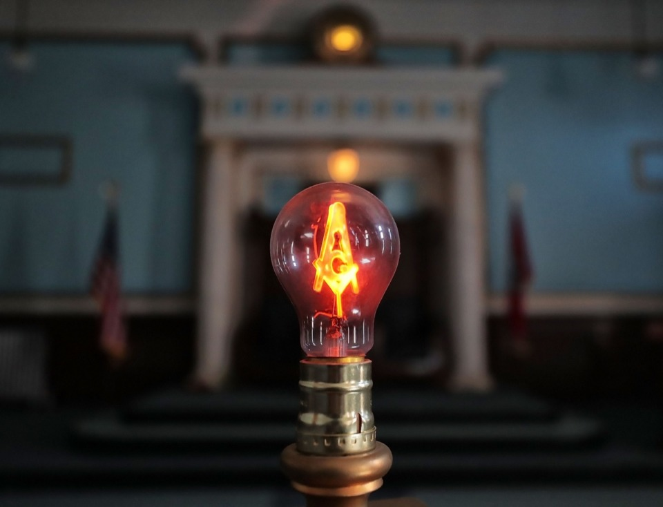 <strong>The square and compasses, symbols of the Freemasons, are everywhere in the Masonic Lodge on Court Avenue, even as a filament illuminating the Desoto Lodge room.</strong> (Jim Weber/Daily Memphian)