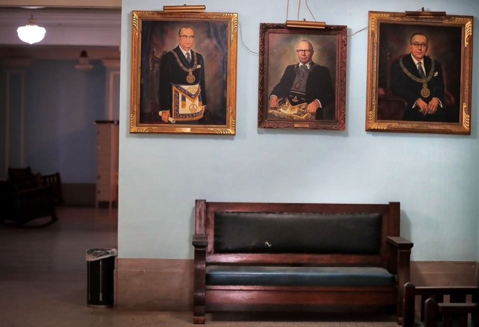 <strong>Old portraits of men who are probably long gone adorn the walls of the 106-year-old Masonic Lodge on Court Avenue.</strong> (Jim Weber/Daily Memphian)