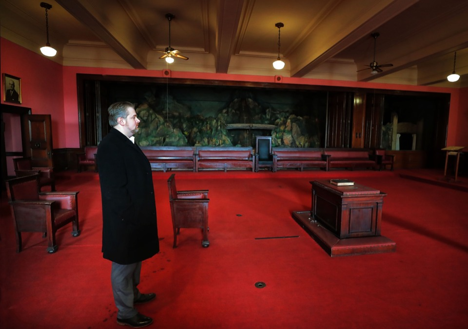 <strong>Avison Young's James McCraw, a past master Mason and broker, shows off the various lodge rooms of the Masonic Temple on Court, which has come on the market.</strong> (Jim Weber/Daily Memphian)