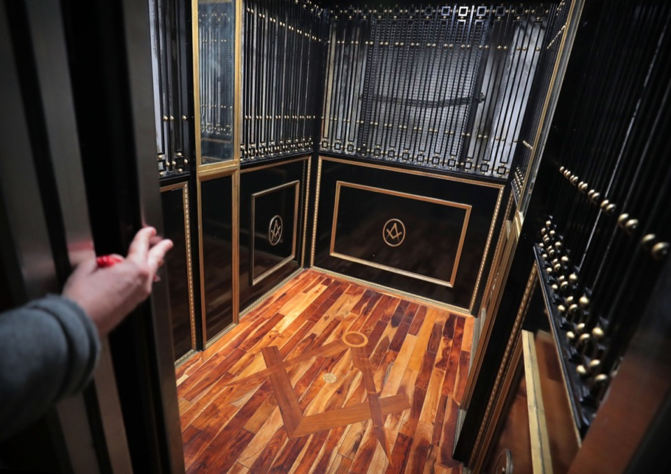 <strong>The square and compasses show up even in an elaborately decorated elevator on a Feb. 8, 2020, tour of the Masonic Temple at 272 Court.</strong> (Jim Weber/Daily Memphian)