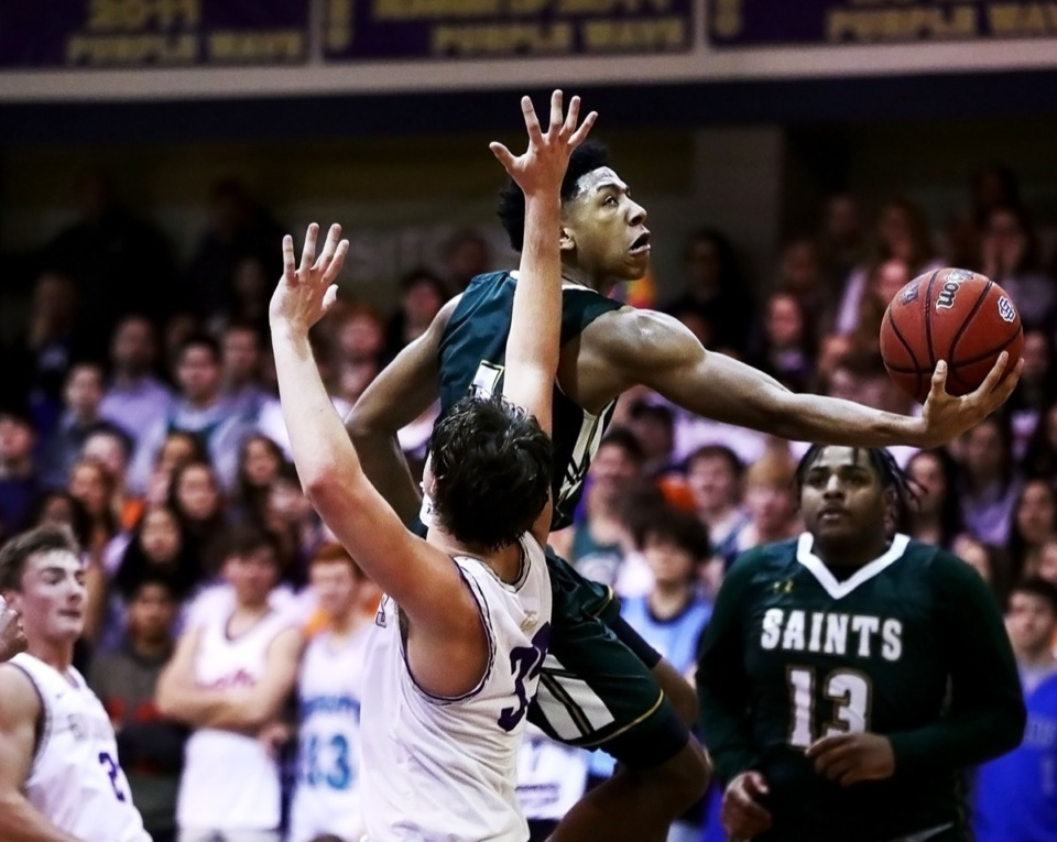 <strong>Briarcrest guard Kennedy Chandler (with ball) drives to the basket against CBHS Feb. 7, 2020.</strong> (Patrick Lantrip/Daily Memphian)