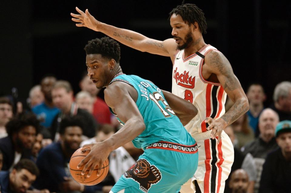 <strong>Memphis Grizzlies forward Jaren Jackson Jr. (13) is defended by Portland Trail Blazers forward Trevor Ariza (8) Feb. 12, 2020, at FedExForum.</strong>&nbsp;(Brandon Dill/AP)