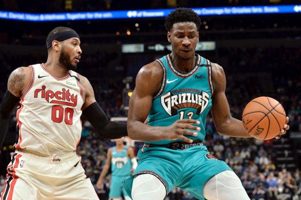 <strong>Memphis Grizzlies forward Jaren Jackson Jr. (13) is defended by Portland Trail Blazers forward Carmelo Anthony (00)&nbsp;Feb. 12, 2020, at FedExForum.</strong> (Brandon Dill/AP)