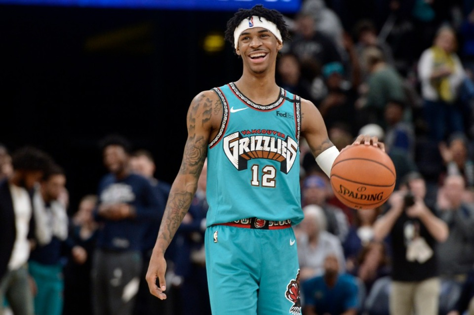 <strong>Memphis Grizzlies guard Ja Morant (12) waits for time to expire in the second half of an NBA basketball game against the Portland Trail Blazers Wednesday, Feb. 12, 2020.</strong> (AP Photo/Brandon Dill)