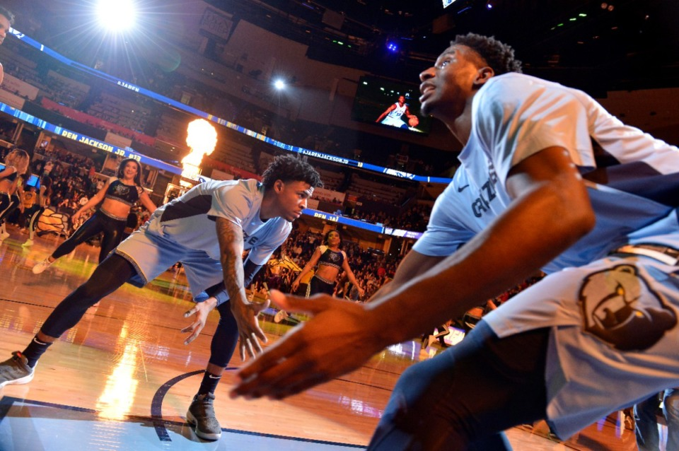 <strong>Memphis Grizzlies guard Ja Morant, left, and forward Jaren Jackson Jr. greet each other during player introductions before an NBA basketball game against the Sacramento Kings Saturday, Dec. 21, 2019, in Memphis, Tenn.</strong> (AP Photo/Brandon Dill)