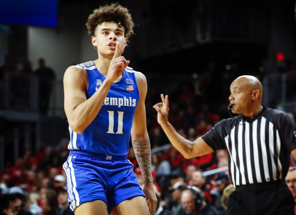 <strong>Memphis guard Lester Quinones hushes the Cincinnati fans after making a 3-pointer Feb. 13, 2020 in Cincinnati.</strong> (Mark Weber/Daily Memphian)