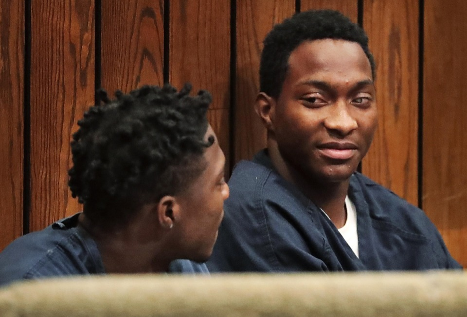 <strong>Chauncy Black, the teen who asked a stranger to buy him doughnuts and ended up the beneficiary of a generous GoFundMe campaign, waits with his brother Timothy Black (left) in Judge Gerald Skahan's court on Thursday, Feb. 13, for the start of a preliminary hearing on a murder charge.</strong> (Jim Weber/Daily Memphian)