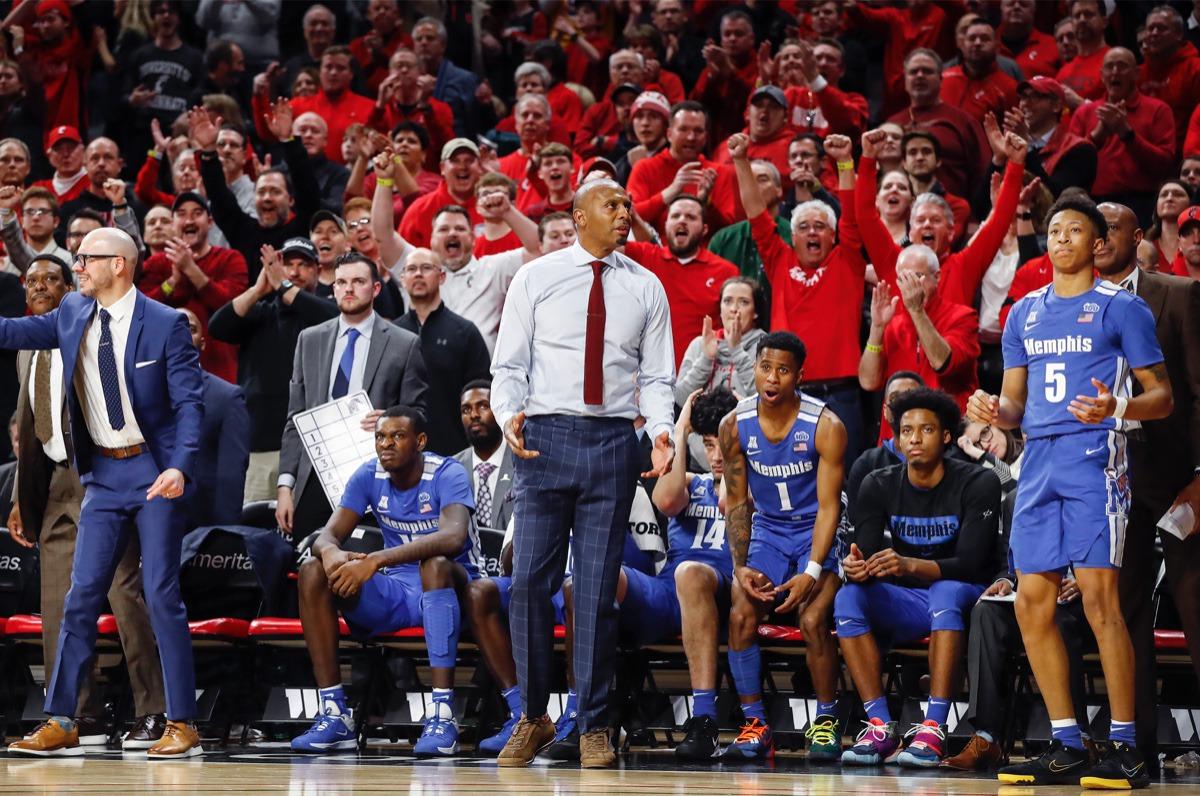 <strong>Cincinnati fans cheer as the Memphis bench reacts to guard Boogie Ellis' (right) shot-clock violation Feb. 13, 2020, in Cincinnati.</strong> (Mark Weber/Daily Memphian)