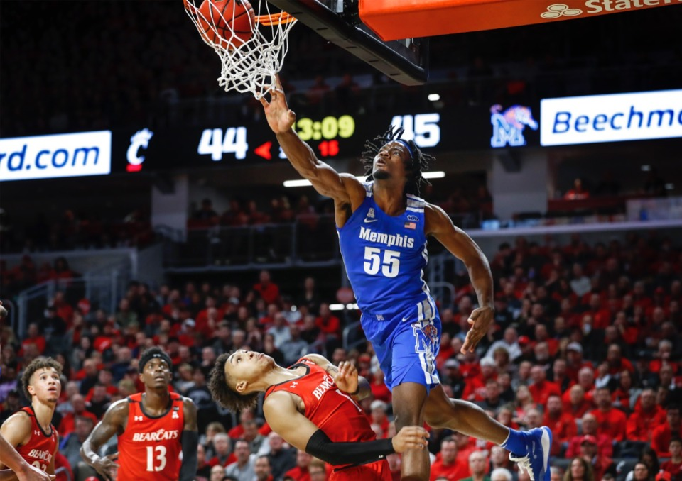 <strong>Memphis forward Precious Achiuwa (top) dunks over Cincinnati defender Jeremiah Davenport (bottom) Feb. 13, 2020.</strong> (Mark Weber/Daily Memphian)