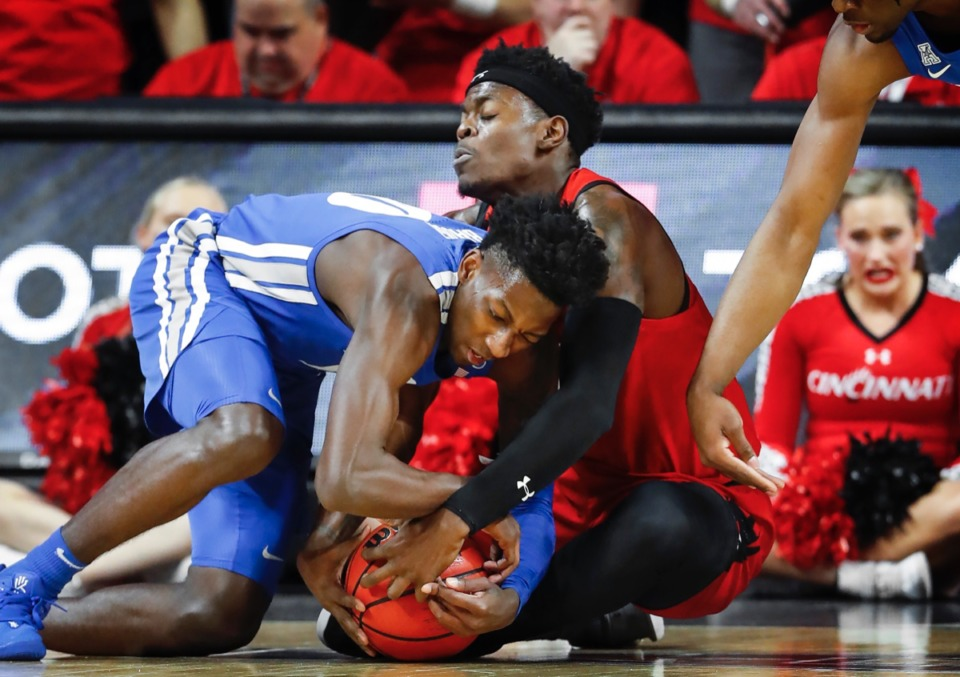 <strong>Memphis guard Damion Baugh (left) battles Cincinnati forward Tre Scott (right) for a loose ball Feb. 13, 2020.</strong> (Mark Weber/Daily Memphian)