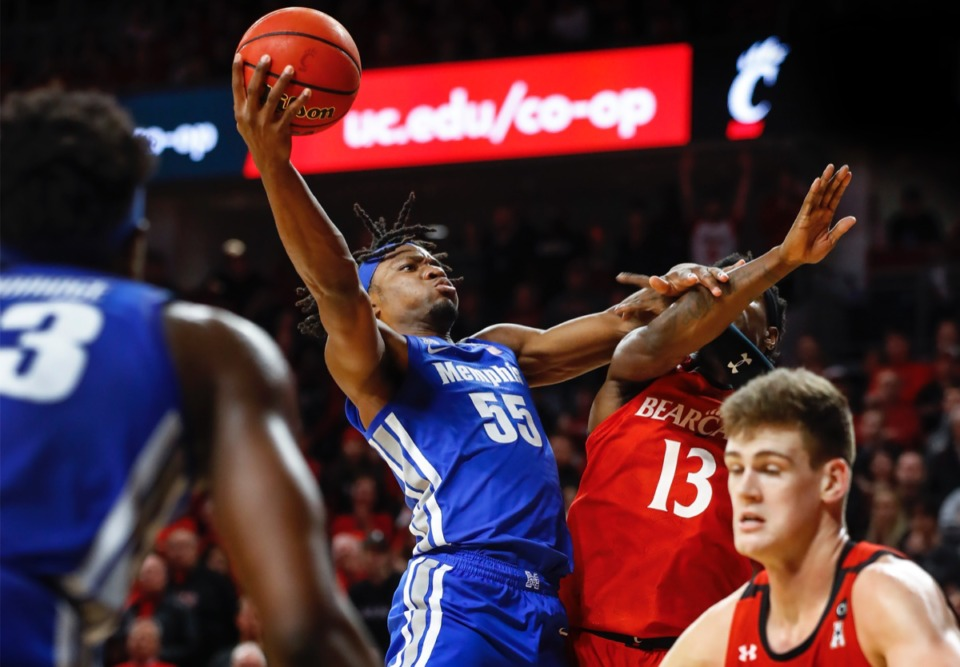 <strong>Memphis forward Precious Achiuwa (middle left) drives to the basket against Cincinnati defender Tre Scott (middle right) Thursday, Feb. 13, 2020.</strong> (Mark Weber/Daily Memphian)
